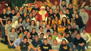 Occasionally swimming had nothing to do with water- it meant team photos with Santa on surprising December afternoons.